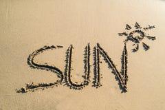 Słowa słońce na pięknym piasku Obraz Stock