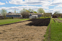 Sowed field in front of the house Royalty Free Stock Image