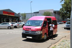 Soweto tour. Small bus to visit Soweto townships royalty free stock photo