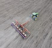 Sowing of corn. Tractor with a seeder on the field. Using a seed royalty free stock images