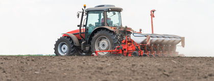 Sowing crops at field Stock Photography