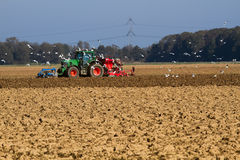 Sowing the field with tractor Stock Images