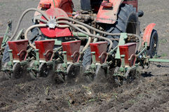 Sowing a field with a tractor Stock Photography