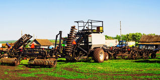 Sowing machine. With seeding and plowing tools for planting season Stock Photos