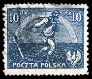 Sowing man, Signing of peace treaty with Russia serie, circa 1921. MOSCOW, RUSSIA - MARCH 23, 2019: Postage stamp printed in Poland shows Sowing man, Signing of royalty free stock image