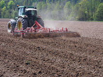 Sowing soil preparation with tractor Royalty Free Stock Images