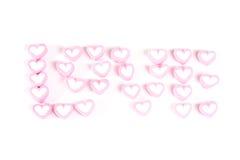 Słowo miłość od różowych cukierków odizolowywających Zdjęcia Royalty Free