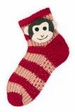 Sox de la Navidad con el mono en el fondo blanco Imagen de archivo libre de regalías