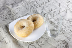 Soy bean doughnuts and empty glass Stock Photography
