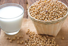 Soy bean and soy milk. On wood background Stock Photography