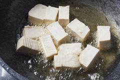 Soy bean tofu while frying in pan Royalty Free Stock Photo