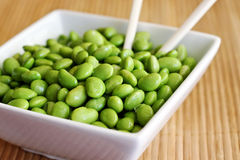 Soy Beans in Bowl. Soy beans in a bowl with chopsticks Royalty Free Stock Images
