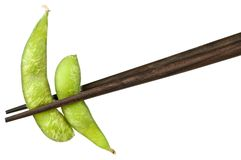 Soy beans with chopsticks Royalty Free Stock Photos