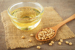 Soy beans and oil on sack Royalty Free Stock Photography