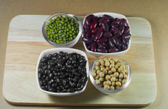 Soy beans, Red beans, black beans and green beans with the healt Stock Photography