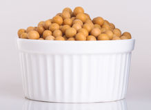 Soy beans in white bowl on white background Royalty Free Stock Photography