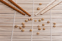 Soy and chopsticks Stock Images
