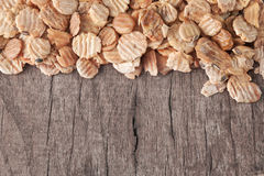 Soy flakes. On old wooden plank Royalty Free Stock Photo