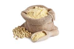 Soy flour in a small bag. Soy flour in a small jute bag isolated on white background royalty free stock image