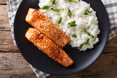 Soy-Honey Glazed salmon and camolino rice close-up. horizontal t Royalty Free Stock Photos