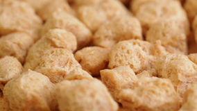 Soy meat at rotating stand closeup stock footage