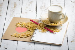 Soy milk cup Beans and Hart in Book on White Wooden Stock Images