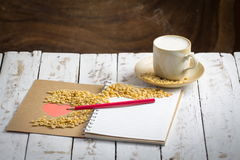 Soy milk cup Beans and Hart in Book on White Wooden Stock Image