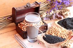 Soy milk mix black sesame with soybean seed and black sesame see Stock Image