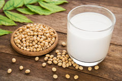 Soy milk and soy bean on wooden table stock photography