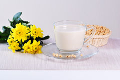 Soy milk with soy beans on table Royalty Free Stock Photography