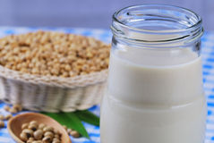 Soy milk with soy beans on table Stock Image