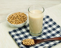 Soy milk and soybean. Soy milk and soybean on wood table Stock Image