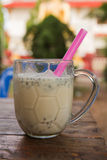 Soy milk with straw Royalty Free Stock Images