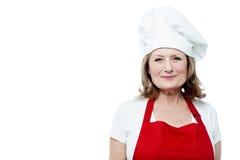 Soy nuevo cocinero de sexo femenino aquí imagen de archivo