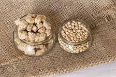 Soy beans and flakes on burlap royalty free stock image