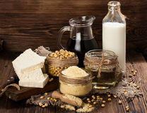 Soy products (soy flour, tofu, soy milk, soy sauce). On a wooden background. rustic style Royalty Free Stock Photography