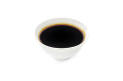 Soy sauce in bowl isolated on white Stock Image
