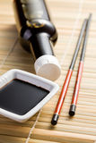 Soy sauce and chopsticks Stock Photo