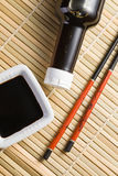 Soy sauce and chopsticks Stock Photography