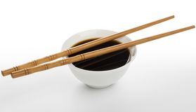 Soy sauce and chopsticks isolated on white background Royalty Free Stock Photo