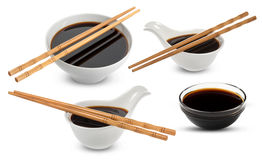 Soy sauce and chopsticks isolated on white Royalty Free Stock Image