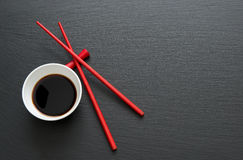Soy sauce with chopsticks Stock Photography