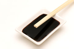 Soy sauce dish and chopsticks Royalty Free Stock Photos