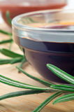 Soy sauce in a glass and a sprig of rosemary Royalty Free Stock Images