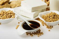 Soy sauce and other products made form soybean. Soy sauce with other products made from soybean over white background Stock Image