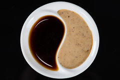 Soy sauce in the plate Yin Yang Royalty Free Stock Image