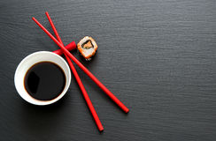 Soy sauce with red chopsticks Stock Image