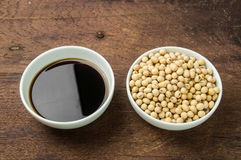 Soy sauce and soy bean in white bowl Royalty Free Stock Photography