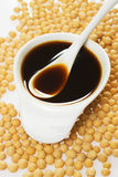 Soy sauce and soybean. On white background Stock Images
