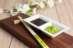 Soy sauce, wasabi and chopsticks Royalty Free Stock Images